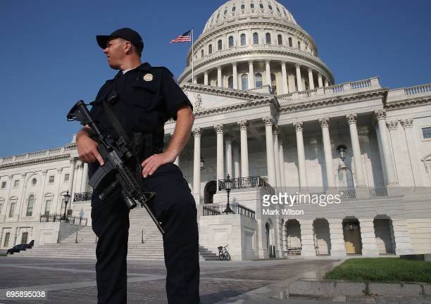 S Capitol Police officer stands guard in front of the US Capitol Building on June 14 2017 in Washington DC This morning House Majority Whip Steve...