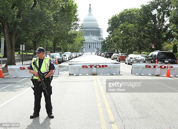 Capitol Police officer stands guard in front of the US Capitol that was currently under lock down July 12 2016 in Washington DC The lock down was...