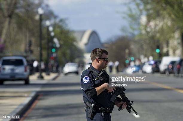 A US Capitol police officer stands on patrol after shots were fired at the visitor's center of the Capitol building in Washington DC US on Monday...