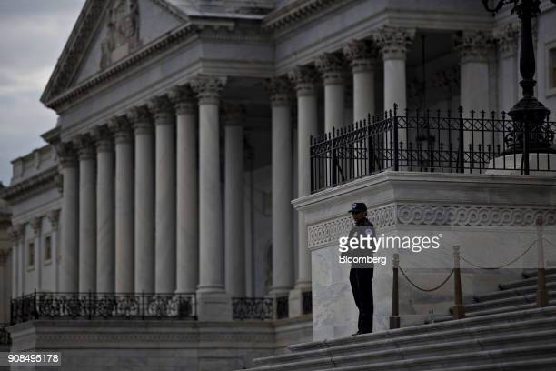 A US Capitol police officer stands outside the Capitol in Washington DC US on Sunday Jan 21 2018 The House and Senate are back in session Sunday with...