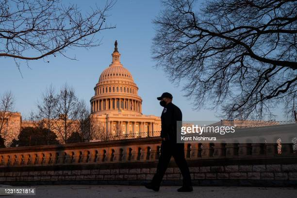 Capitol Police Officer walks around the Capitol grounds on the West front of the U.S. Capitol Building, which saw boosted security, Thursday, after...