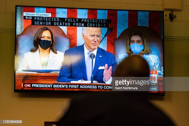 Capitol Police Officer watches President Joe Bidens address of the Joint Session of the 117th Congress on a television in the Senate Press Gallery,...