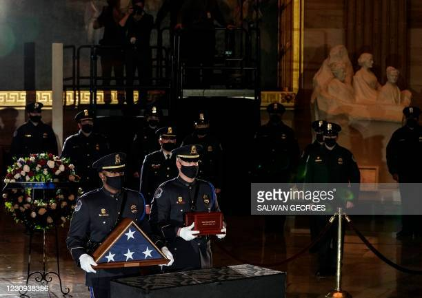 Capitol Police Officers carry the urn holding the remains of fellow officer Brian Sicknick, to lie in honor in the Capitol Rotunda in Washington,...