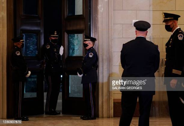 Capitol Police Officers gather in the Capitol Rotunda where fellow officer Brian Sicknick will lie in honor in Washington, DC, February 2, 2021. -...