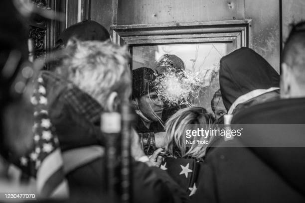 Image was converted to black and white) Capitol police officers inside the U.S. Capitol on January 06, 2021 in Washington, DC. The protesters stormed...