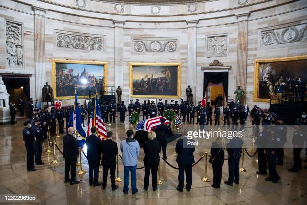 Capitol Police officers pay their respects to Officer William Evans as his remains lie in honor in the Capitol Rotunda on April 13, 2021 in...