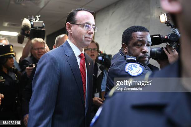 S Capitol Police officers shove journalists out of the way as Deputy Attorney General Rod Rosenstein leaves the Hart Senate Office Building following...