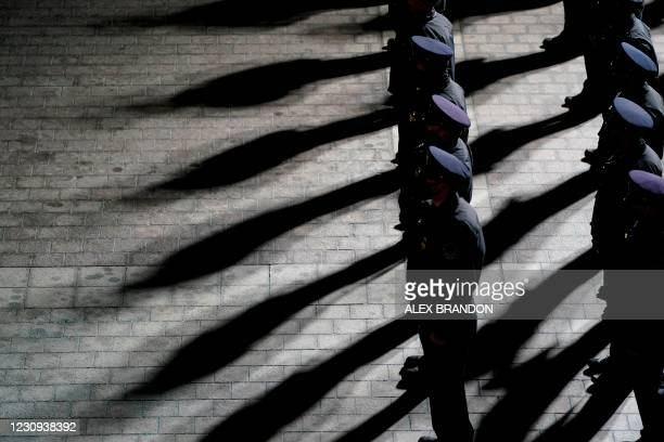 Capitol Police officers stand at attention as an urn with the cremated remains of US Capitol Police officer Brian Sicknick arrives at the US Capitol...