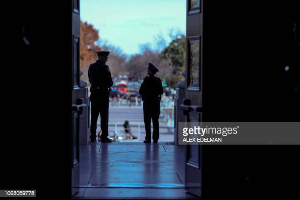 US Capitol Police Officers stand guard at the US Capitol before the remains of former US President George H W Bush lay in state at the US Capitol's...