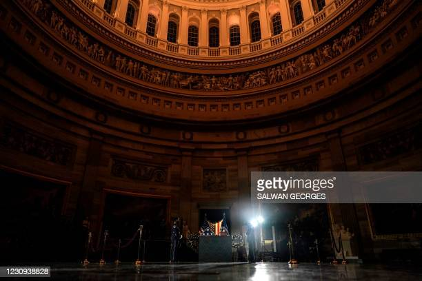 Capitol Police Officers stand guard next to the remains of late US Capitol Police officer Brian Sicknick as he lies in honor in the US Capitol...
