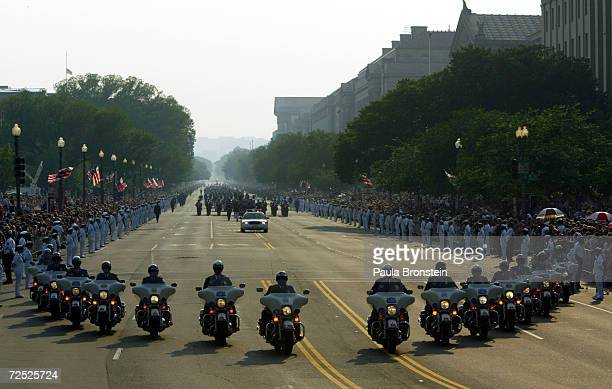 Capitol Police on motorcycles lead the horse drawn procession as it makes its way down Constitution Avenue enroute to the Capitol June 9 2004 in...