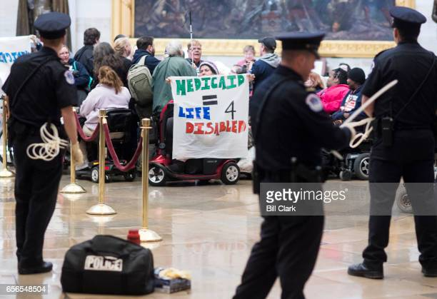 S Capitol Police prepare flex cuffs to arrest members of ADAPT protesting in the Capitol rotunda against the American Health Care Act of 2017 and...