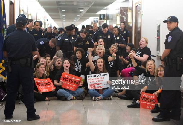 US Capitol Police prepare to arrest demonstrators as they protest against the nomination of Judge Brett Kavanaugh to be a Supreme Court Justice...