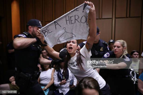 S Capitol Police remove a protester from the hearing room during the second day of Supreme Court nominee Judge Brett Kavanaugh's confirmation hearing...
