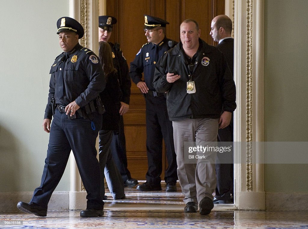 U.S. Capitol Police respond to a report of a suspicious package near Senate Majority Leader Harry Reid's offices on the second floor of the U.S. Capitol on Wednesday, Nov. 4, 2009.