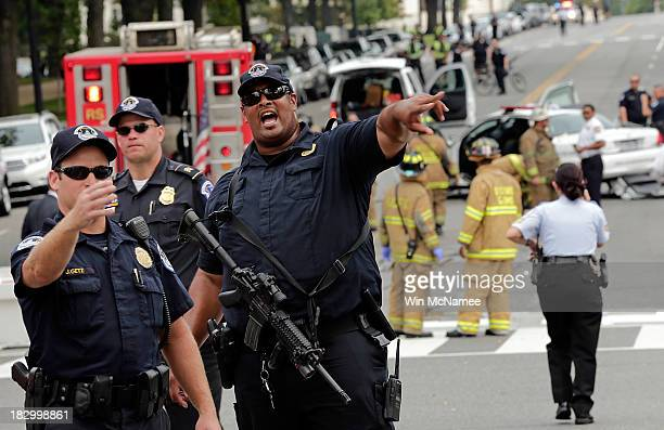 S Capitol police respond to reports of shots fired at the US Capitol October 3 2013 in Washington DC Capitol police locked down the facility during...