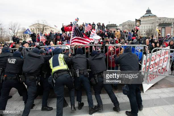 Capitol Police scuffle with demonstrators after they broke through security fencing outside of the U.S. Capitol building in Washington, D.C., U.S.,...