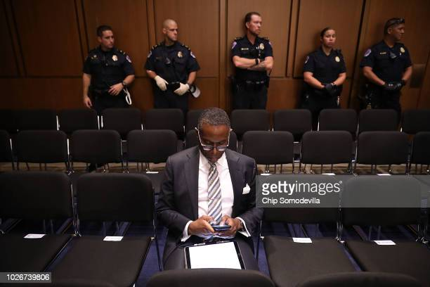 Capitol Police stand by after clearing the public seating of protesters during Judge Brett Kavanaugh's Supreme Court confirmation hearing before the...