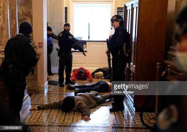 Capitol Police stand detain protesters outside of the House Chamber during a joint session of Congress on January 06, 2021 in Washington, DC....