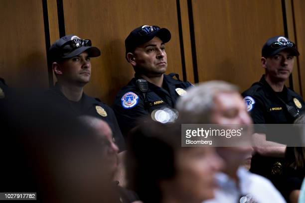 US Capitol police stand in a hearing room during a Senate Judiciary Committee confirmation hearing for Brett Kavanaugh US Supreme Court associate...