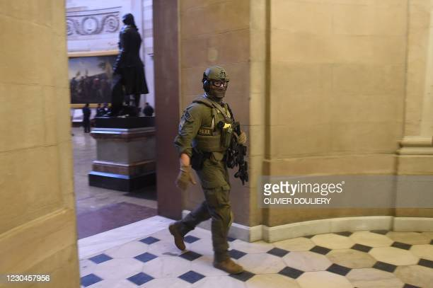 Capitol Police Swat team member patrols the US Capitol in Washington, DC on January 6, 2021. - Donald Trump's supporters stormed a session of...