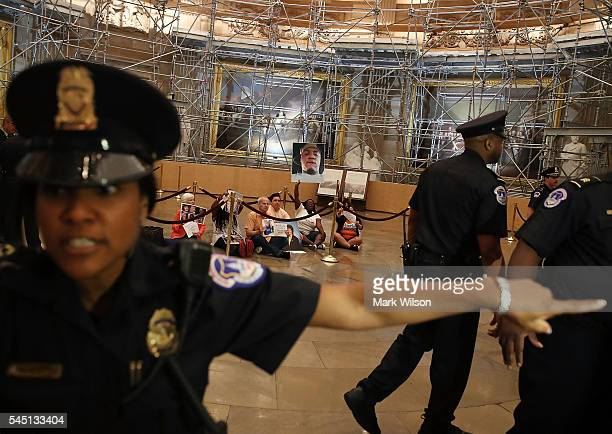Capitol Police try to clear the area as family members and friends of victims of gun violence stage a sitin inside the US Capitol Rotunda July 5 2016...