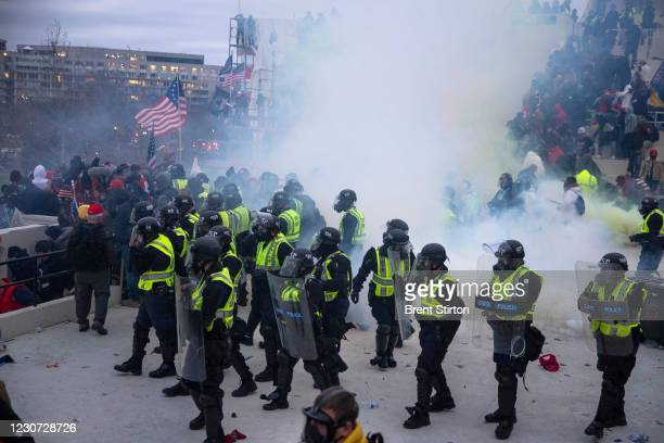 Capitol police use pepper spray and tear gas to clear the capitol. Trump supporters clashed with police and security forces as people try to storm...