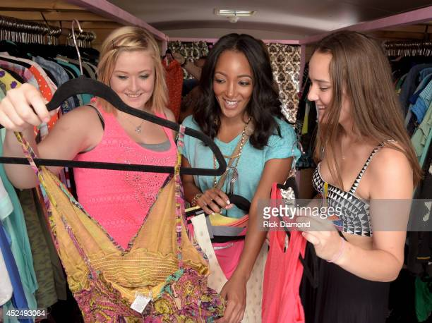 Capitol Records Nashville recording artist Mickey Guyton and Threads for Teens founder Allison Ahlstrom help a teen in the style studio at the...