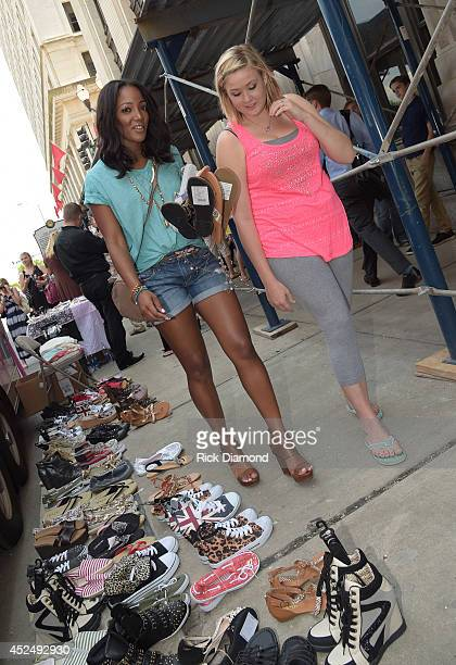 Capitol Records Nashville recording artist Mickey Guyton helps a teen in the style studio at the Threads For Teens Mobile Boutique Tour at Hotel...