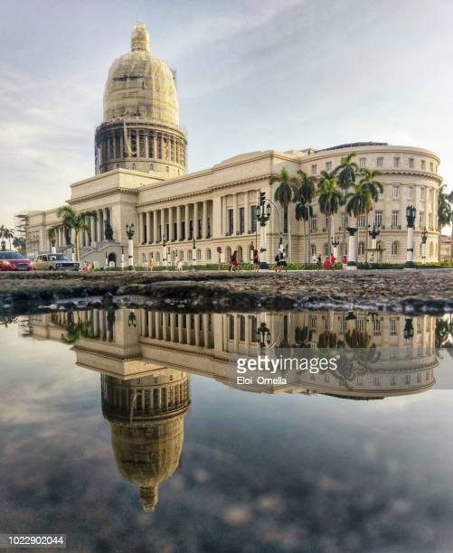 capitol reflected into water. havana. cuba - old havana stock pictures, royalty-free photos & images
