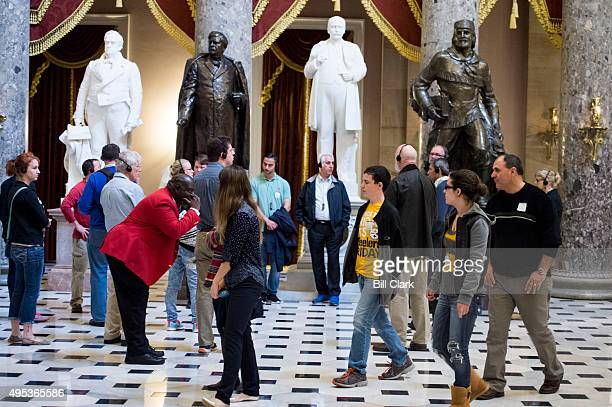Capitol tour guide leans in above the whisper spot in Statuary Hall as he leads his tour group through the Capitol on Monday Nov 2 2015
