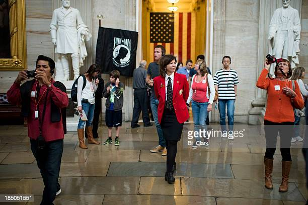 Capitol tour guides returned to work on Thursday Oct 17 after the Senate and House passed legislation to end the government shutdown and avert the...