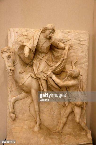 Capitoline museum, Rome. Pietro Bernini. St Martin divides his coat with a beggar. 1595-98. High relief, white Carrara marble. Italy.