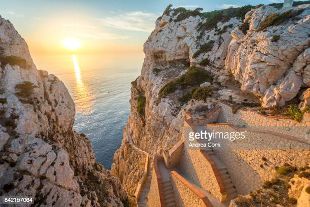 Capo Caccia, Alghero, Sardinia. the Incredible staircase of Neptuno grotto at sunset