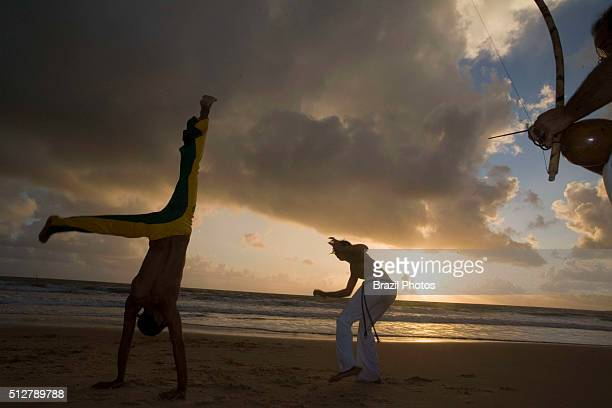Capoeira a Brazilian martial art that combines elements of dance acrobatics and music and is usually referred to as a game known for quick and...