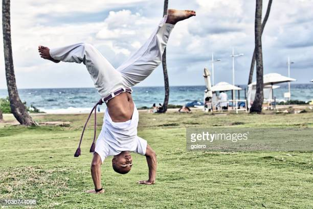 capoeira at beach in salvador da bahia - handstand stock pictures, royalty-free photos & images