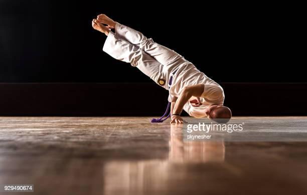 capoeira athlete in motion! - capoeira imagens e fotografias de stock
