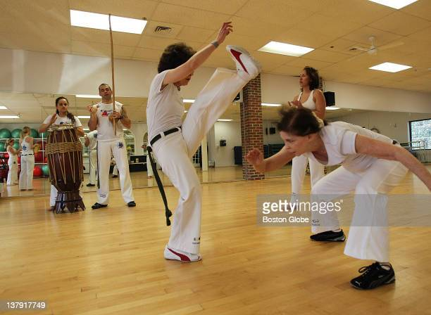 A capoeira class is taught in Wellesley by Marcus Coreba He combines dance music and martial arts in the teaching of capoeira On right is Lucy Morris...