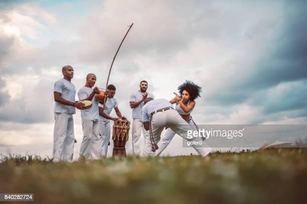 capoeira combat at beach in salvador brazil - capoeira imagens e fotografias de stock