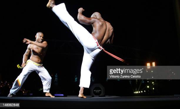 Capoeira dancers perform during the OCTO The New Architecture of Time by Bulgari dinner at the Stadio dei Marmi on July 13 2012 in Rome Italy