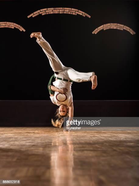 capoeira female athlete doing a handstand on sports training in a health club. - capoeira imagens e fotografias de stock