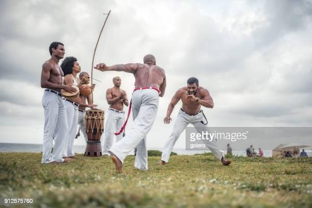 capoeira fight at beach of salvador brazil - capoeira imagens e fotografias de stock