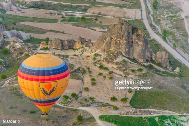 cappadocia is known around the world as one of the best places to fly with hot air balloons. goreme, cappadocia, turkey - central anatolia stock photos and pictures