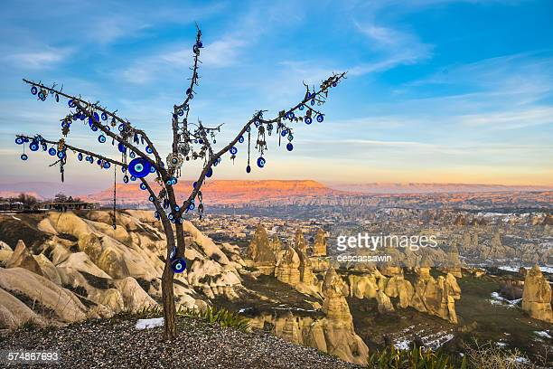 cappadocia sunset with an evil eye tree - portafortuna foto e immagini stock