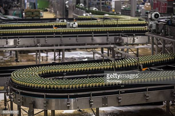 Capped and labelled bottles of beer move along conveyor belts on the automated production line at the Pilsner Urquell brewery operated by SABMiller...