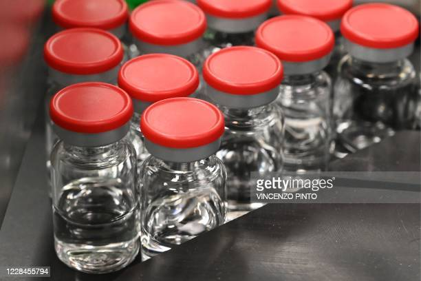 Capped vials are being pictured during filling and packaging tests for the large-scale production and supply of the University of Oxfords COVID-19...