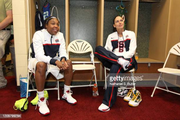 Cappie Pondexter and Sue Bird of the USA Basketball Team looks on in the locker room before the game against the WNBA team during the Stars at the...