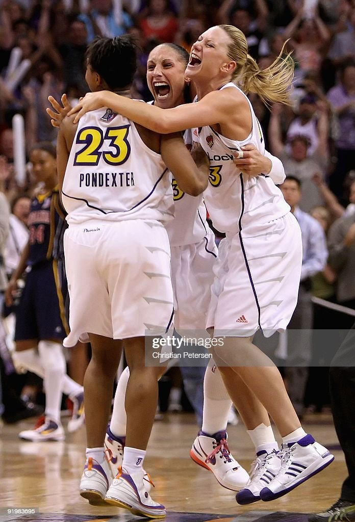 Cappie Pondexter #23, Diana Taurasi #3 and Penny Taylor #13 of the Phoenix Mercury celebrate after defeating the Indiana Fever in Game Five of the 2009 WNBA Finals at US Airways Center on October 10, 2009 in Phoenix, Arizona. The Mercury defeated the Fever 94-86.