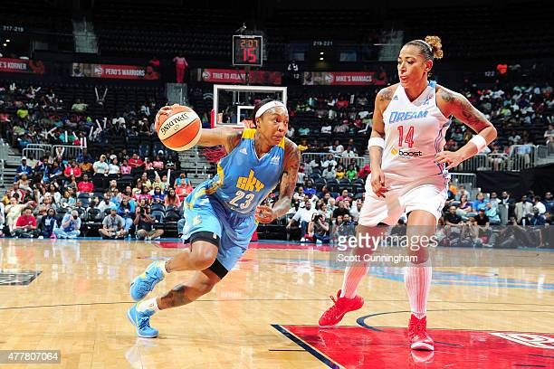 Cappie Pondexter of the Chicago Sky drives to the basket against Allie Quigley of the Chicago Sky drives to the during the game at Philips Center on...