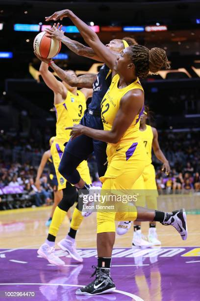 Cappie Pondexter of the Indiana Fever handles the ball against Jantel Lavender of the Los Angeles Sparks during a WNBA basketball game at Staples...